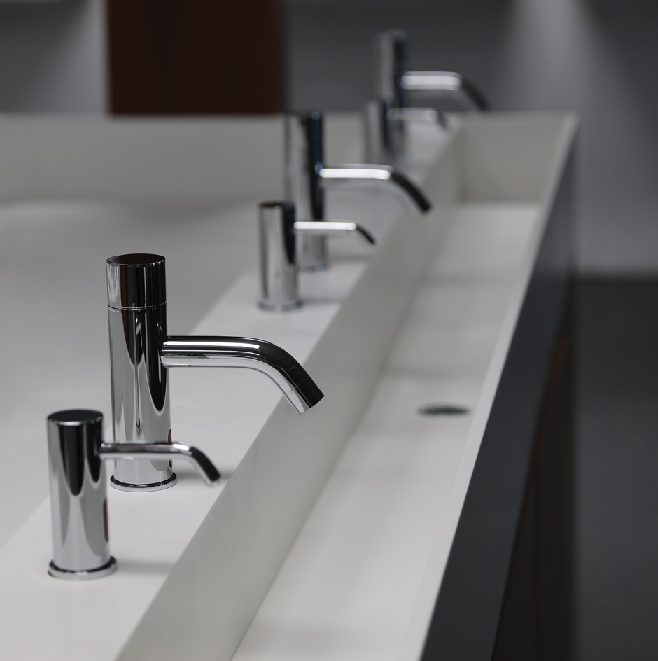 Custom solid surface sink with electronic faucet EX10A and soap dispenser EX05A.
